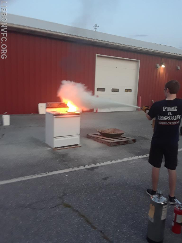 EMT McKee demonstrates the proper distance & application method of an ABC extinguisher on a stovetop grease fire.